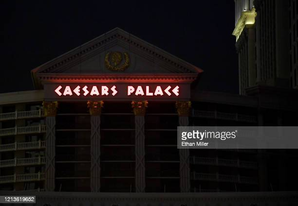 Most of the exterior building lights at Caesars Palace are turned off as parts of the Las Vegas Strip go dark as a result of the statewide shutdown...