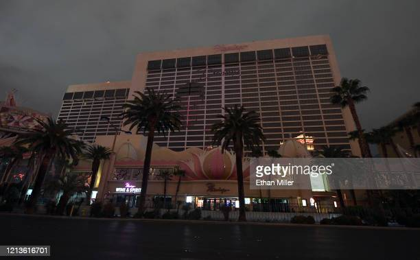Most of the exterior building lights at Flamingo Las Vegas are turned off as parts of the Las Vegas Strip go dark as a result of the statewide...