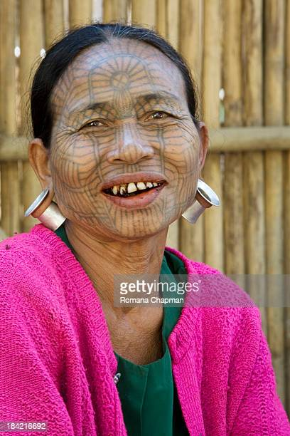 Most of the old chin tribal women sport these tattoos, all the same - a spider's web. The large earrings are commonly seen in the older generation of...