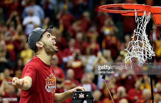 Most outstanding player Georges Niang of the Iowa State Cyclones cuts down a piece of the net after their 70 to 66 victory over the Kansas Jayhawks...