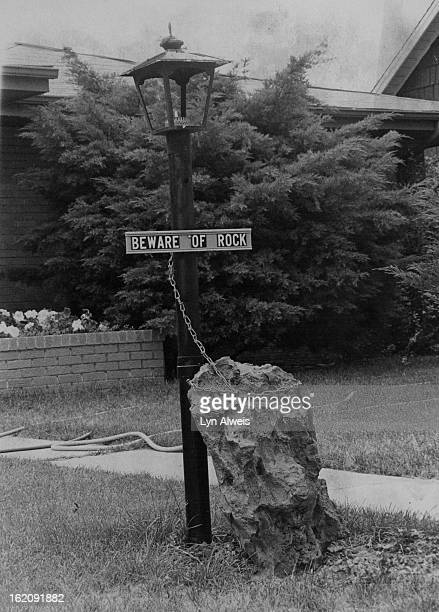 JUL 21 1977 JUL 31 1977 Most passersby smile when they see this warning at home of a rock hound family