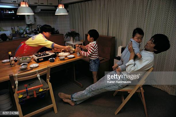 Most urban Japanese live in an urban highrise called a 'Danchi' This family Noriko and Takashi Shoji have two children Kota and Daisuka Takashi plays...