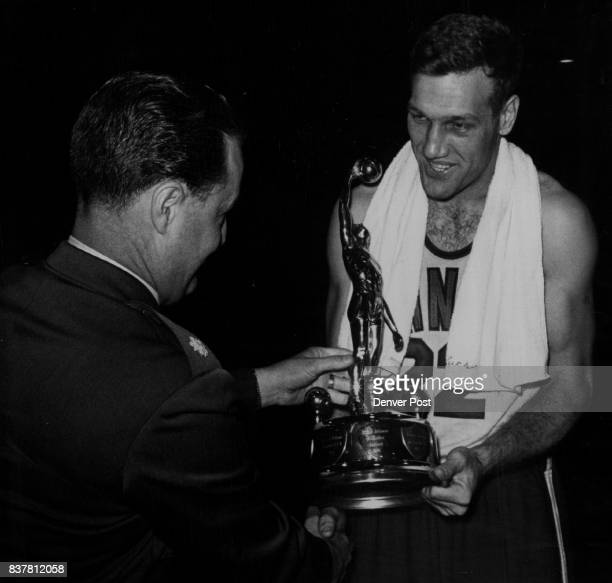 Most Valuable Air Force Player Bob Hodges of Pacific Air Force receives trophy as most valuable player in the Air Force basketball meet from Lt Col...