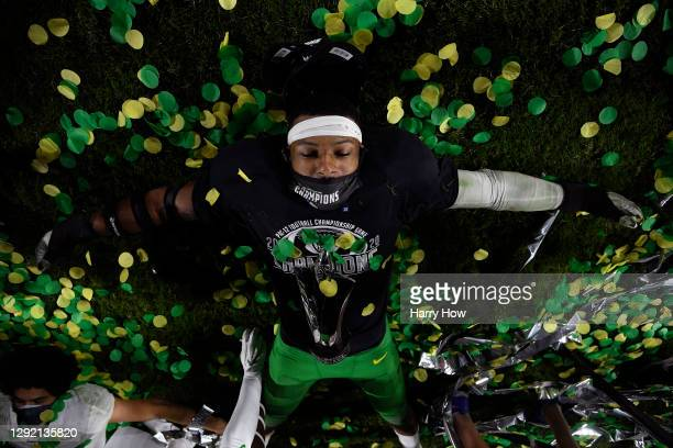 Most valuable player of the game, Kayvon Thibodeaux of the Oregon Ducks, celebrates a 31-24 win over the USC Trojans by making a snow angel on the...