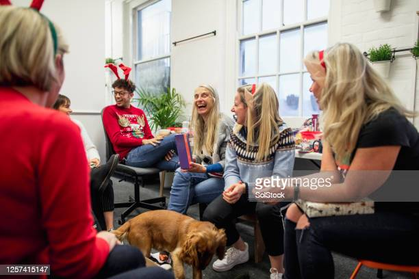 most wonderful time of the year - ugly christmas sweater party stock pictures, royalty-free photos & images