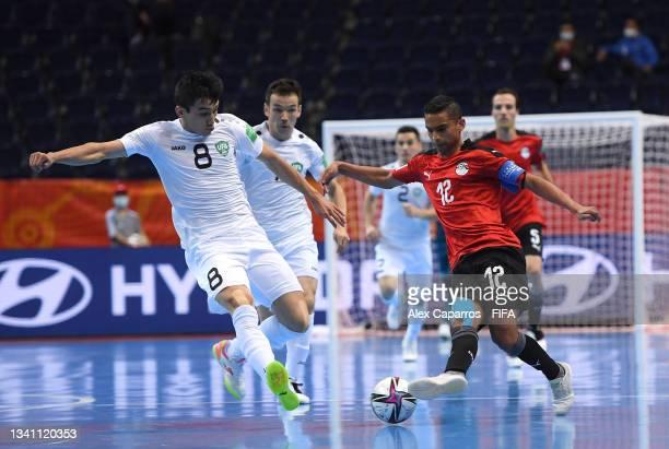 Mostafa Eid of Egypt and Khusniddin Nishonov of Uzbekistan challenge for the ball during the FIFA Futsal World Cup 2021 group B match between Egypt...