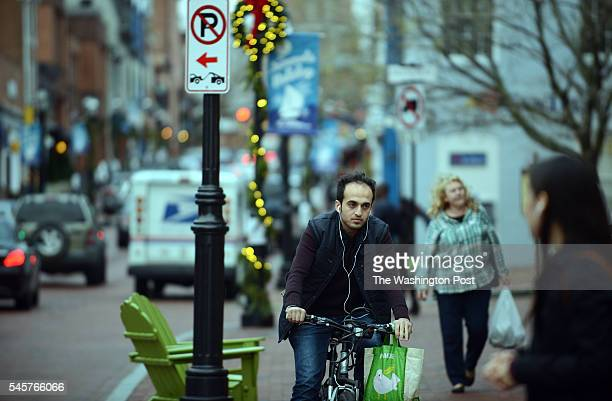 Mostafa Hassoun, a 23-year-old Syrian refugee, rides his bicycle home from work to his group house in Annapolis, MD, December 14, 2015. Mostafa came...