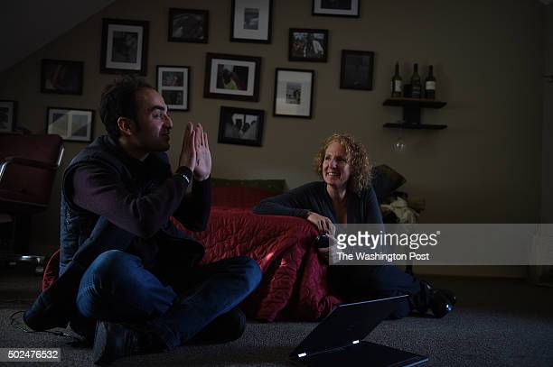 Mostafa Hassoun, a 23-year-old Syrian refugee, spends some time with his friend Maria Ulbricht inside his room of his group home in Annapolis, MD,...