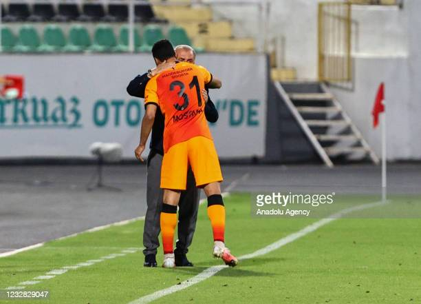 Mostafa Mohamed Ahmed Abdalla of Galatasaray celebrates with his head coach Fatih Terim after scoring a goal during the Turkish Super Lig week 41...