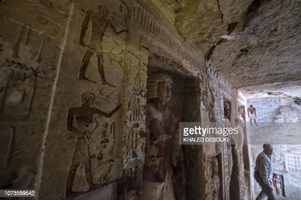 Mostafa Waziri Secretary General of Egypt's Supreme Council of Antiquities walks in a newlydiscovered tomb at the Saqqara necropolis 30 kilometres...