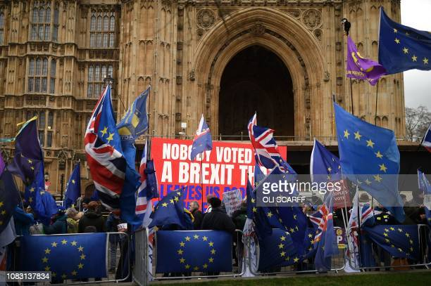 Mostly antiBrexit protesters wave EU and Union flags with one UK Independence Party flag outside the Houses of Parliament in central London on...