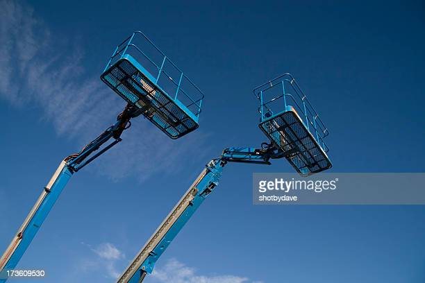 mostly blue - crane construction machinery stock pictures, royalty-free photos & images