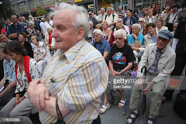 Mostly elderly visitors attend an election campaign event of the German left-wing party Die Linke in Koepenick district on August 27, 2013 in Berlin,...