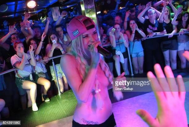 Mostly Germanspeaking visitors cheer as German singer Mia Julia a former porn actress performs topless at the Oberbayern disco on the Ballermann...