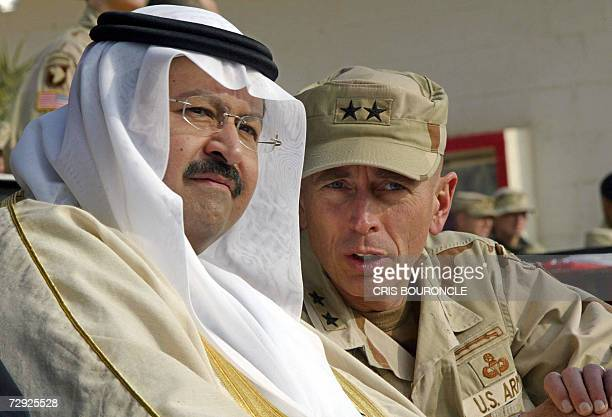 In this 06 January 2004 file photo US Maj Gen David Petraeus speaks with Sheikh Ghazi alYawer of the Shumer tribe and member of the interim Iraqi...