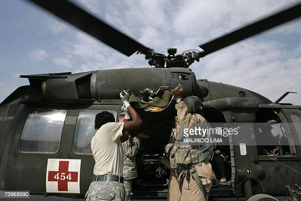 US army medics rush into a Black Hawk helicopter to evacuate a wounded Iraqi soldier wrapped in a thermal blanket in the northern Iraqi city of Mosul...