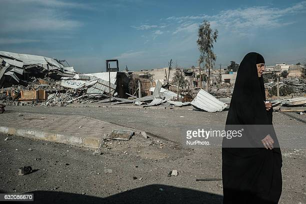 Mosul IraqWoman in hijab walking in MosulIraqi forces have retaken control of east Mosul from the Islamic State groupThe city is cut in half by the...