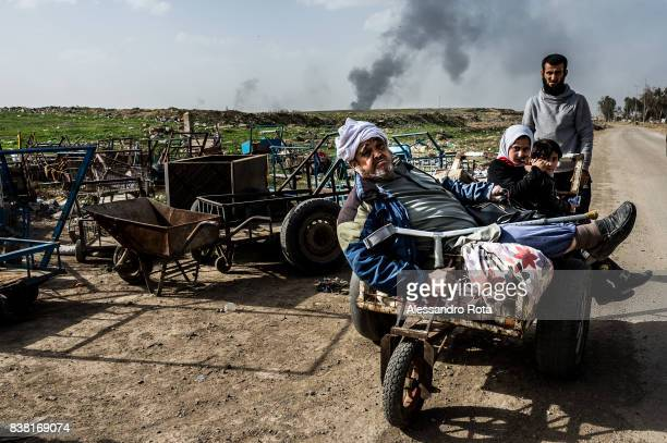IRAQ Mosul West 12 Mar 2017 Civilians escape from the airport sector