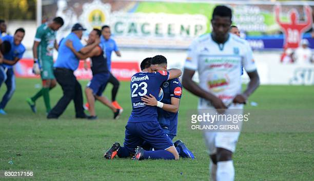 Motagua players celebrate winning the Honuran Apertura Football Tournament after their 11 tie with Platense in Puerto Cortes 280km north of...