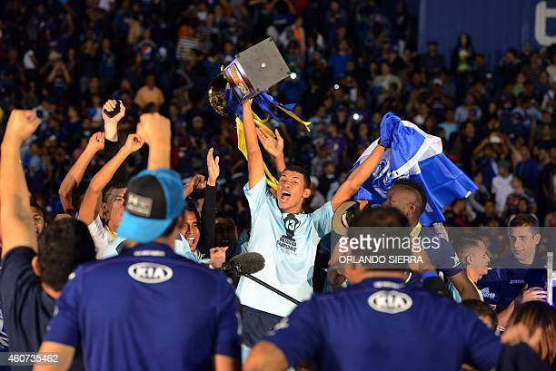 Motagua's player raises the Champion Cup of the Apertura tournament 20142015 of the Honduras soccer in Tegucigalpa on December 20 2014 AFP...