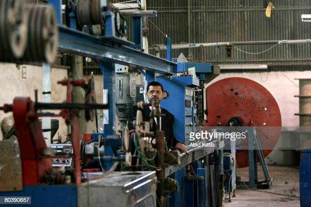 Mo'taz AlHaddad one of the AlHaddad factory owners inspects the stopped machines at the electrical components and cables factory AlHaddad on March 26...