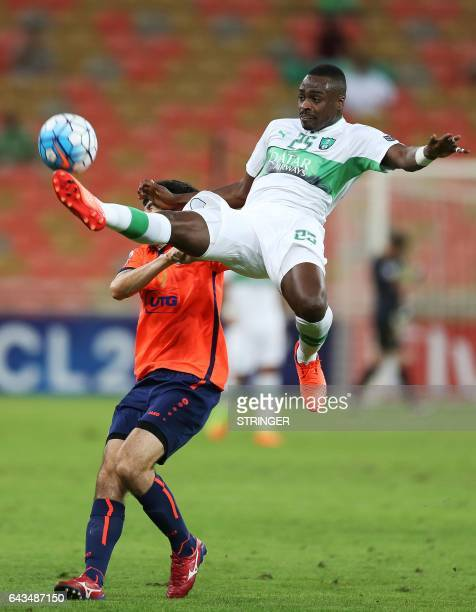 Motaz Hawsawi from Saudi's AlAhli fights for the ball against Shahzodbek Nurmatov from Uzbekistan's Bunyodkor during their AFC Champions League...