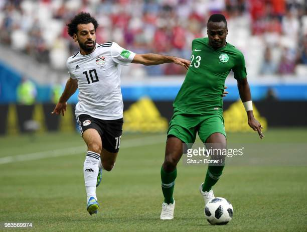 Motaz Hawsawi of Saudi Arabia is challenged by Mohamed Salah of Egypt during the 2018 FIFA World Cup Russia group A match between Saudia Arabia and...