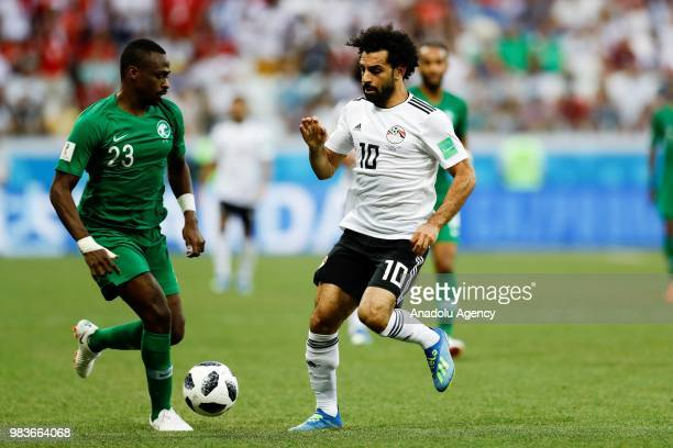 Motaz Hawsawi of Saudi Arabia struggles with his competitor Mohamed Salah of Egypt during the 2018 FIFA World Cup Russia Group A match between Saudi...