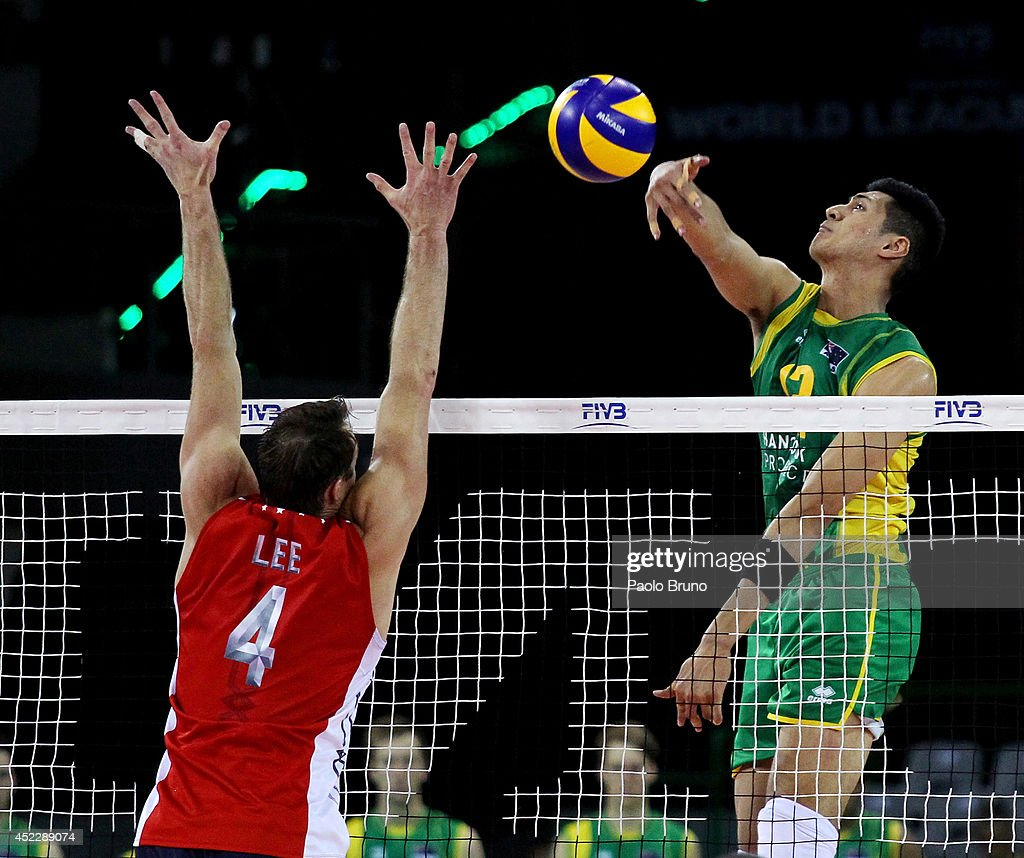 Mote Nehemiah of Australia spikes the ball as David Lee of United States block during the FIVB World League Final Six match between United States and Australia at Mandela Forum on July 17, 2014 in Florence, Italy.