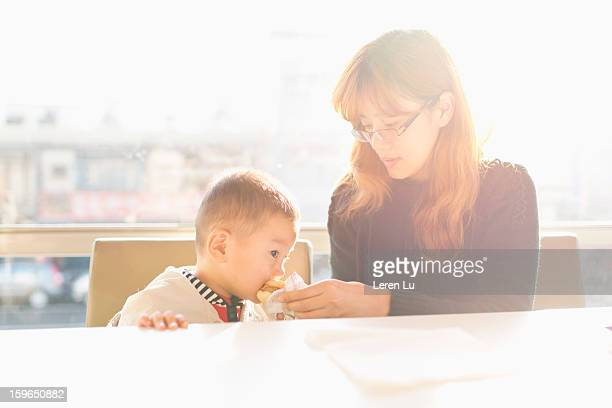 Motehr and child in fast food restaurant