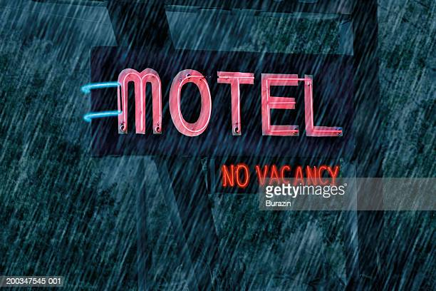 'Motel' and 'No Vacancy'  sign in rain