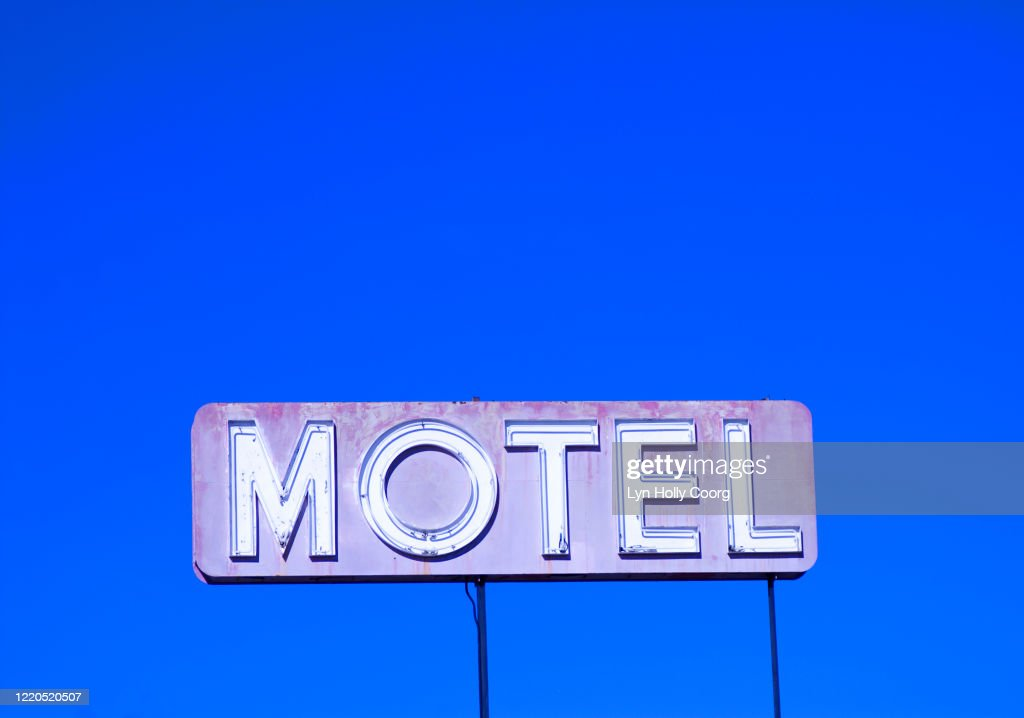 Motel sign against blue sky : Stock Photo