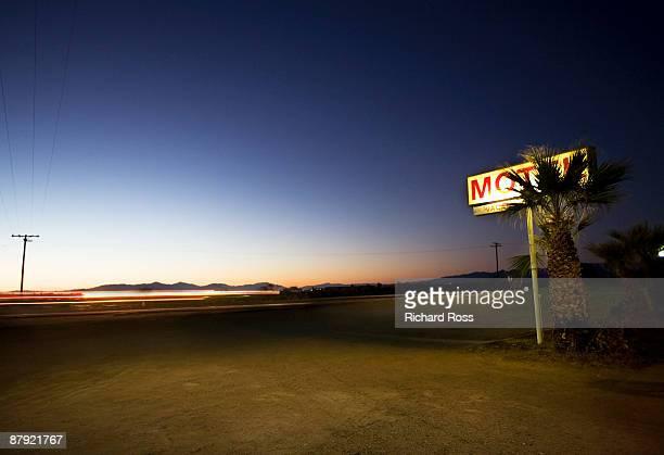 Motel sign along highway at night