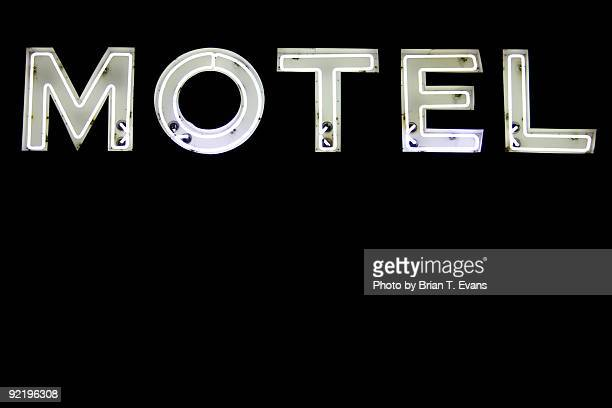 motel sign - neon letters stock photos and pictures