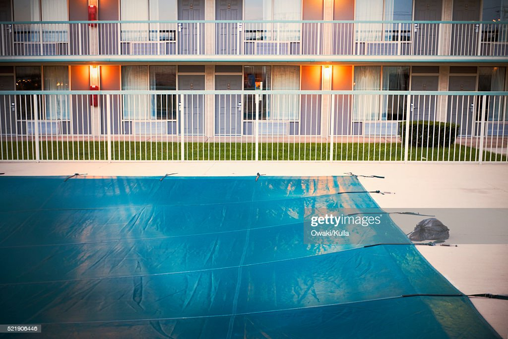Motel Swimming Pool Covered With Tarp Stock-Foto - Getty Images