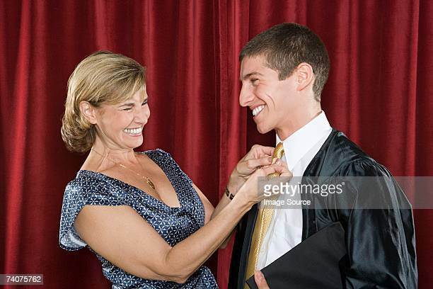 mother adjusting sons tie - adjusting stock pictures, royalty-free photos & images
