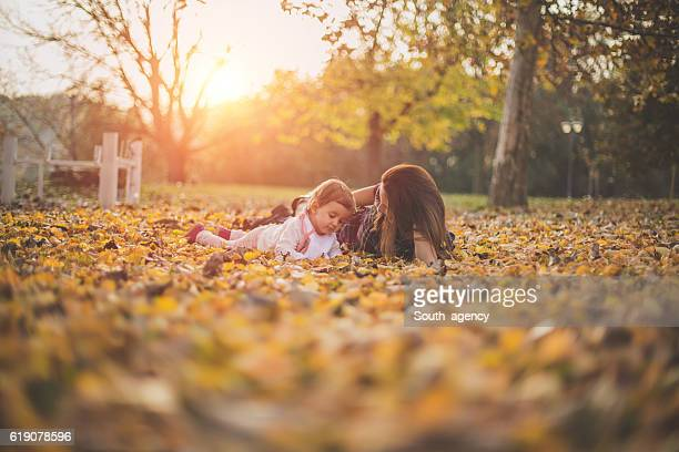 Mother and a baby lying in the park