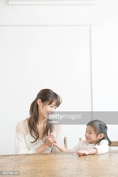 A mother and a daughter who sit