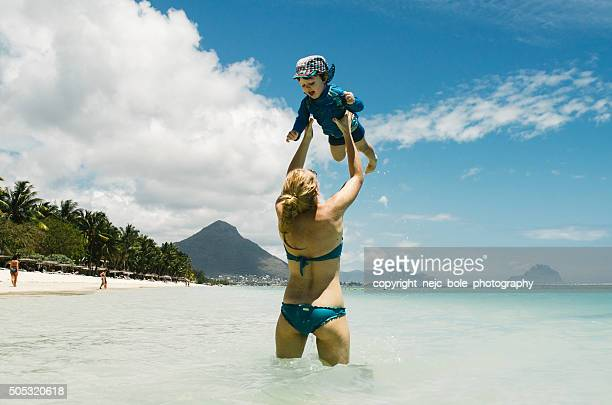 Mother and a son playing in the water