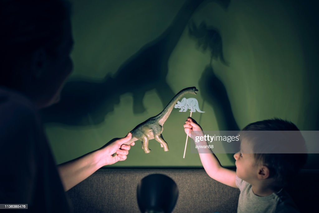 Mother and adorable son playing with shadows : Stock Photo