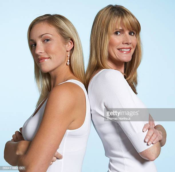 mother and adult daughter back to back, portrait, side view - 背中合わせ ストックフォトと画像