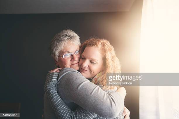 mother and adult daughter embracing