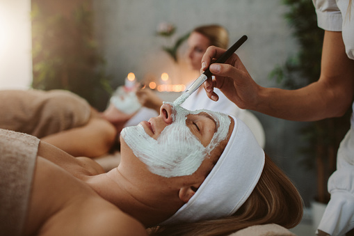 Mother and adult daughter enjoy beauty treatment in a spa center 1058452248