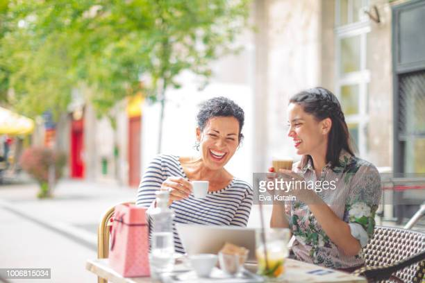 mother and adult daughter spending time together - mother's day stock pictures, royalty-free photos & images