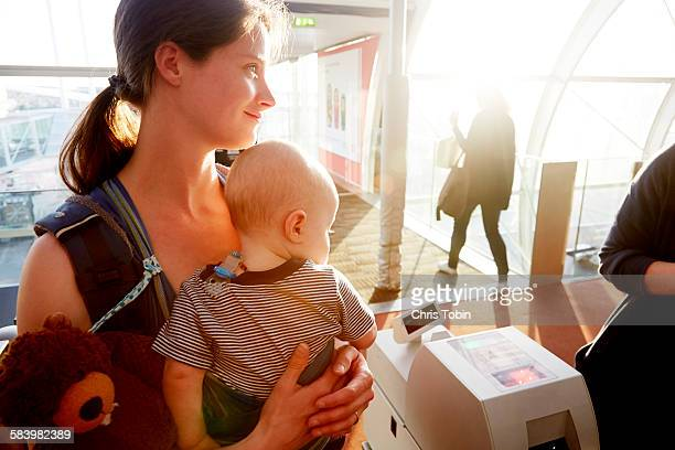 mother and baby at gate check at airport - mama bear stock photos and pictures