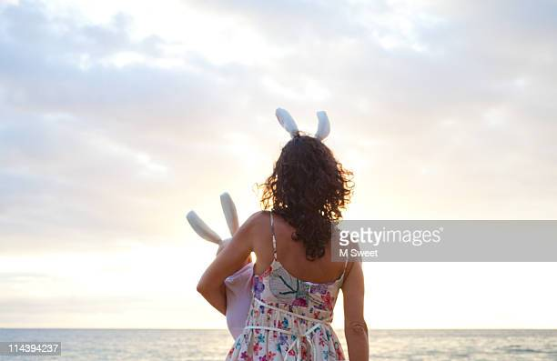 mother and baby at  sunset beach - easter beach stock pictures, royalty-free photos & images
