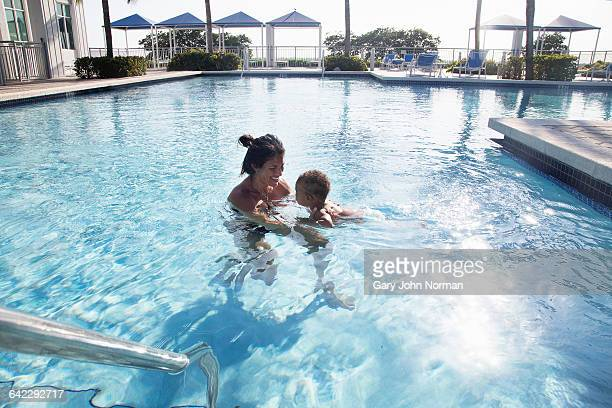 Mother and baby at the swimming pool