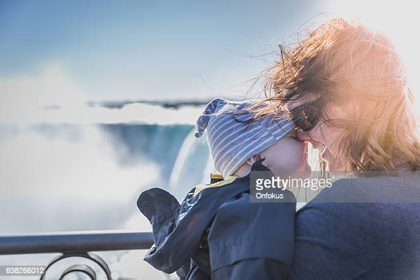 mother and baby boy at niagara falls - niagara falls stock pictures, royalty-free photos & images