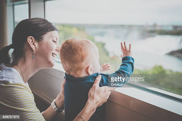 Mother and Baby Boy Looking by The Window, Niagara Falls