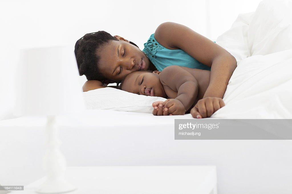 mother and baby boy sleeping : Stock Photo